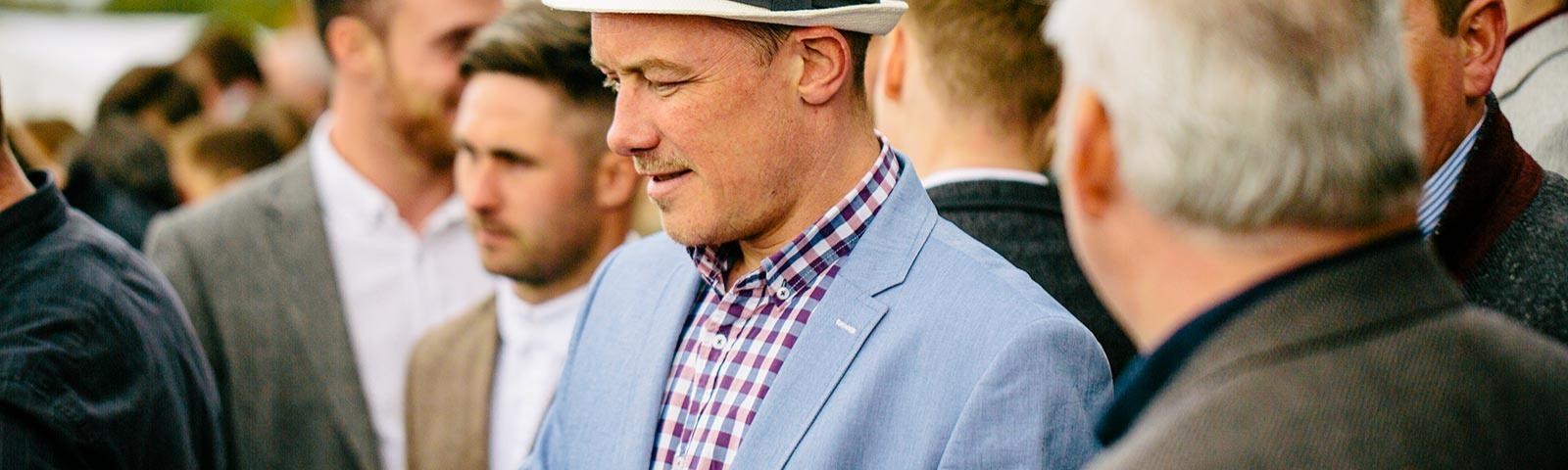 Gents in the crowd at Southwell Racecourse Gentlemans Day