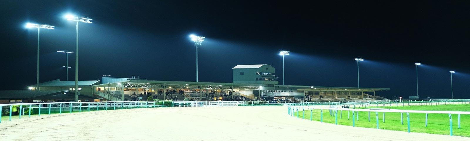 Southwell Racecourse floodlit at night