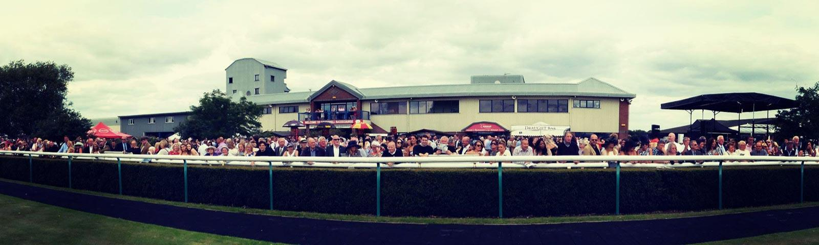 Crowds in front of the grandstand at Southwell Racecourse