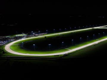 A view of a floodlit race track