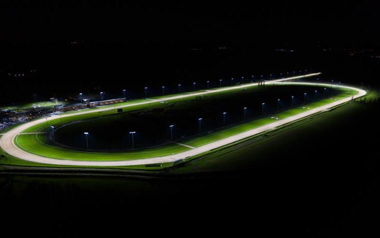 A view of a floodlit racing track